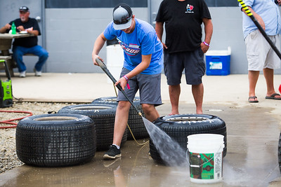 Race teams cleaning tires