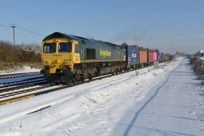 2 February 2019 :: After a heavy snowfall 66534 is photographed at Worting Junction working 4O05 from Birch Coppice to Southampton