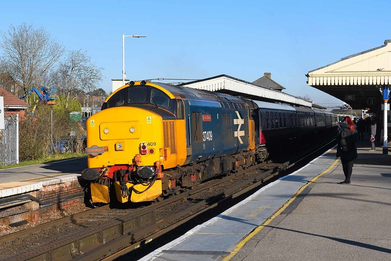 15 February 2019 :: At the rear of Pathfinder railtour 1Z27 from Eastleigh to Dawley Loop is 37409 and seen passing through Basingstoke Station