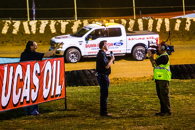 Scott Bloomquist (back) pokes fun at Dave Argabright in the infield during the Lucas Oil broadcast taping prior to the start of the feature