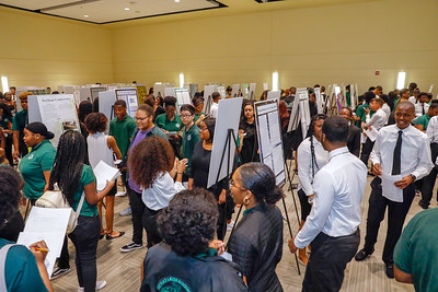 Seniors from Charles Herbert Flowers High School's science and technology program show their research projects during their research symposium, Wednesday, May 1, 2019.