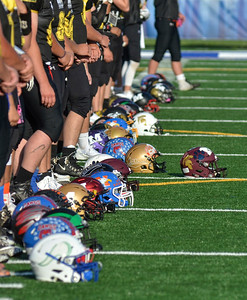 Tribune-Star/Austen Leake Across the Valley: Players' helmets displaying logos from their teammates' schools are lined up prior to Saturday's Wabash Valley Football Coaches Association All-Star Game at Memorial Stadium.