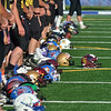 Tribune-Star/Austen Leake<br /> Across the Valley: Players' helmets displaying logos from their teammates' schools are lined up prior to Saturday's Wabash Valley Football Coaches Association All-Star Game at Memorial Stadium.