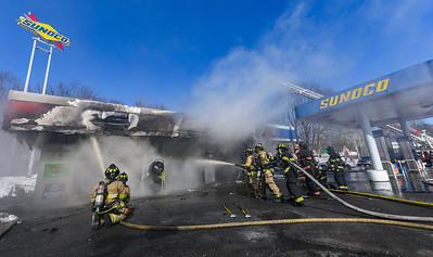 LEOMINSTER - Firefighters battle a 2nd Alarm fire at a Sunoco Gas Station and garage at 468 Main St. Thursday March 7, 2019 [Photo/Jim Marabello]