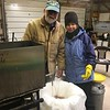 DARREL AND PAM FILTERING SYRUP FOR THE FINAL TIME...BEFORE BOTTLING IT