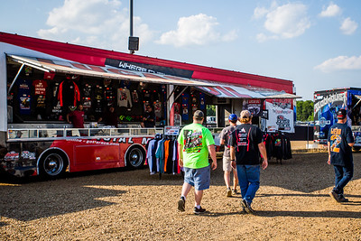 Fans browse apparel at the Arizona Sport Shirts Lucas Oil Late Model Dirt Series merchandise trailer