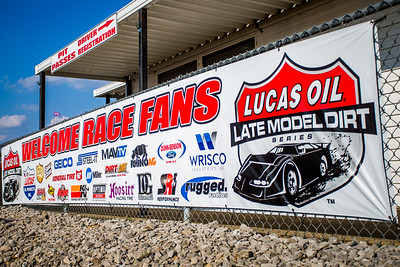 Lucas Oil Late Model Dirt Series Welcome Race Fans banner at the entrance of the speedway