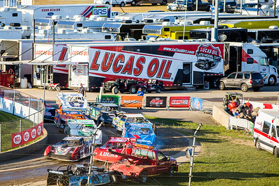 Cars in staging near the Lucas Oil Late Model Dirt Series haulers