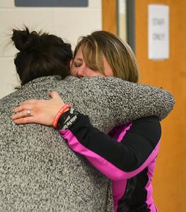 MET 030819 Jayna Sullivan Hug