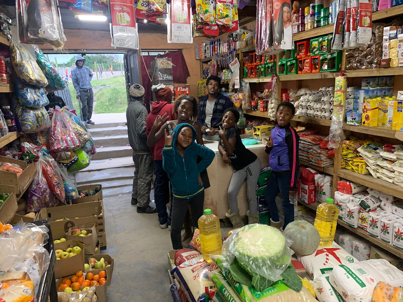 This is a Township's equivalent of a 7-11.  We walked through this shop to get to the family living in the rear