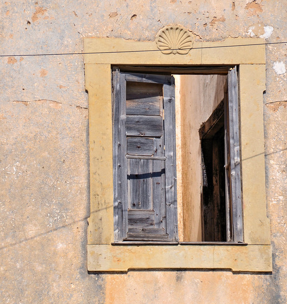 Window of abandoned building in Albufeira