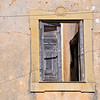 Window of abandoned building in Albufeira