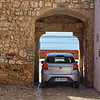 Car squeezing through Porta do Sol