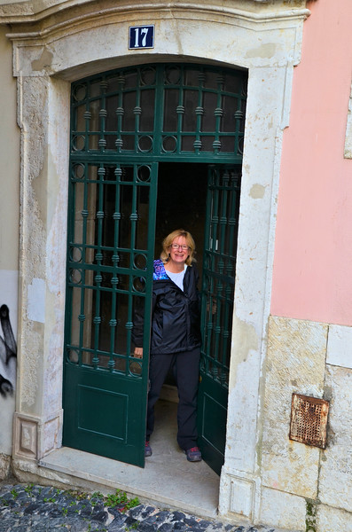 Anne at the entrance to our Lisbon apartment building
