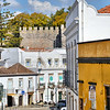 Tavira street with castle walls behind