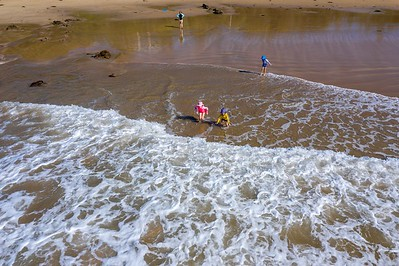 Jumping Over Waves - Low Tide at South Rosedale (Scarlett and Sebastian front, Orlando middle, Emmy behind)