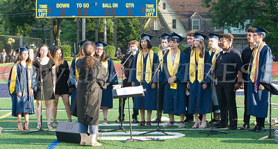 """Members of the NFA Madrigals perform the """"Star Spangled Banner"""" during the Newburgh Free Academy 154th Commencement Exercises for the graduating Class of 2019 on Academy Field in the City of Newburgh, NY on Tuesday, June 25, 2019. Hudson Valley Press/CHUCK STEWART, JR."""