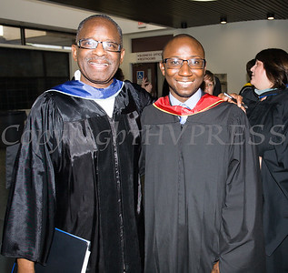 Poughkeepsie High School Acting Principal Ronald Jackson and Keynote Speaker Alhassan Susso during the 147th Commencement Exercises for the graduating Class of 2019 on Friday, June 28, 2019 in Poughkeepsie, NY. Hudson Valley Press/CHUCK STEWART, JR.