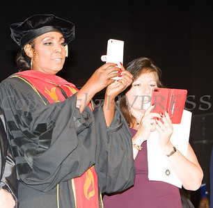 Board of Education President Dr. Felicia Watson and NYS Senator Sue Serino take pictures of the graduates during the Poughkeepsie High School 147th Commencement Exercises for the graduating Class of 2019 on Friday, June 28, 2019 in Poughkeepsie, NY. Hudson Valley Press/CHUCK STEWART, JR.