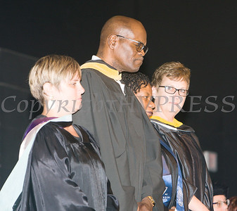 Board of Education member Randall Johnson, second from left, was recognized for his many years of service during the Poughkeepsie High School 147th Commencement Exercises for the graduating Class of 2019 on Friday, June 28, 2019 in Poughkeepsie, NY. Hudson Valley Press/CHUCK STEWART, JR.