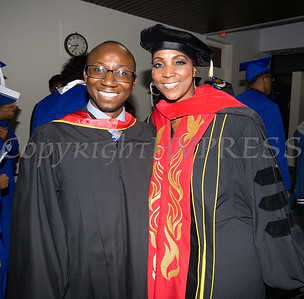 Keynote Speaker Alhassan Susso and Board of Education President Dr. Felicia Watson share a moment during the Poughkeepsie High School 147th Commencement Exercises for the graduating Class of 2019 on Friday, June 28, 2019 in Poughkeepsie, NY. Hudson Valley Press/CHUCK STEWART, JR.