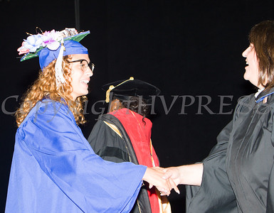 Poughkeepsie High School student Yolvelis Martinez receives her diploma during the 147th Commencement Exercises for the graduating Class of 2019 on Friday, June 28, 2019 in Poughkeepsie, NY. Hudson Valley Press/CHUCK STEWART, JR.