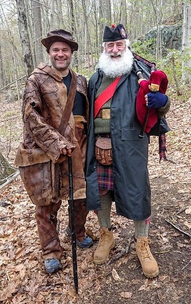 Lee-Stuart Evans dressed as the Old Leather Man along with bagpiper John Henken on the trail of the Leatherman's Loop 10k race on April 28, 2019. (photo courtesy Lee-Stuart Evans)