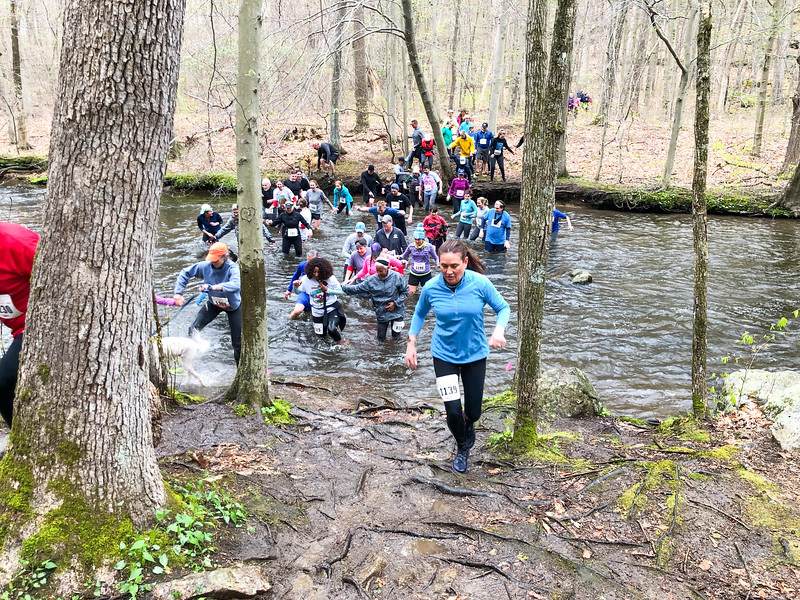 Runners fording the first river crossing at the 1.25 mile mark of the 2019 Leatherman's Loop. (photo by Robert Cummings)