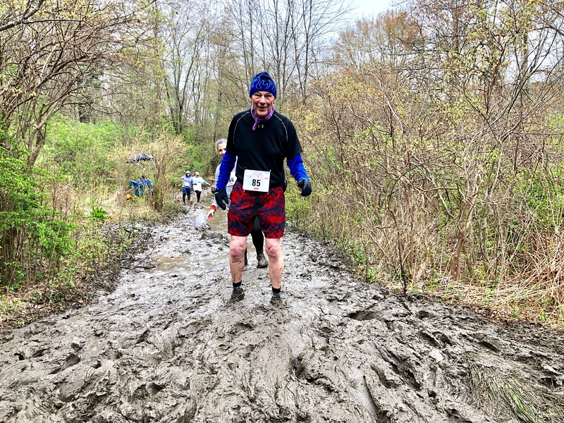 John Young of Ridgefield in the Mud Flats at the 2019 Leatherman's Loop. John is the oldest runner to complete the Loop at 85 years of age. (photo by Rob Cummings)