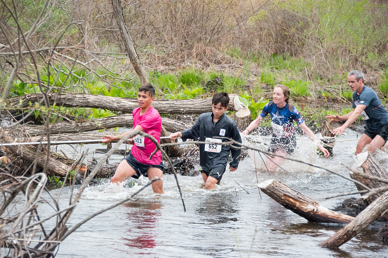 Women's winner Jacqueline Kehoe crosses Splashdown in the final stretch of the Loop. (photo by Sawyer Cummings)