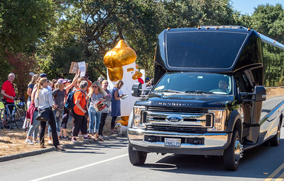 """One of the limo vans that ferried donors to the fundraiser.   The demonstrators chanted """"Shame!"""""""