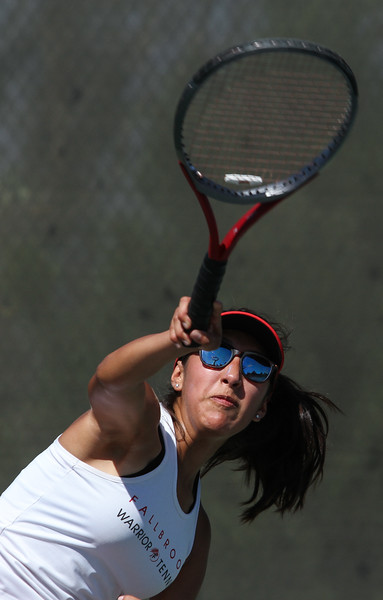 Fallbrook's Alex Guadarrama serves to her El Camino opponent during a singles match.
