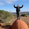 Elder Burk standing on a Termite Mound