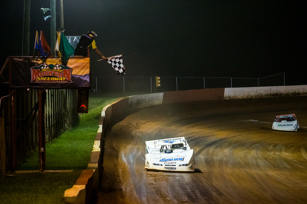 Hudson O'Neal (71) takes the checkered flag in a heat race
