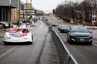 Cars driving along passenger cars