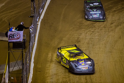 Billy Moyer (21) takes the checkered flag