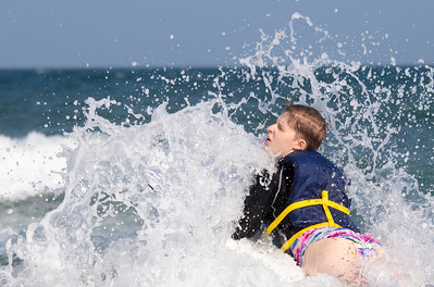 Delilah Baker, 13, pushes through a wave during Indo Jax Surf Charities 12th annual visually impaired surf camp that took place at Wrightsville Beach, N.C. Wednesday, July 17, 2019. The three-day camp involved more than 40 families and concludes on Thursday. The non-profit will hold a fundraiser this Saturday at Liberty Tavern from 1 p.m. – 6 p.m. for their surf therapy programs. [HALEY FRANCE/STARNEWS]