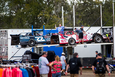 Gregg Satterlee (22) and Brent Larson (B1) unload in the pit area