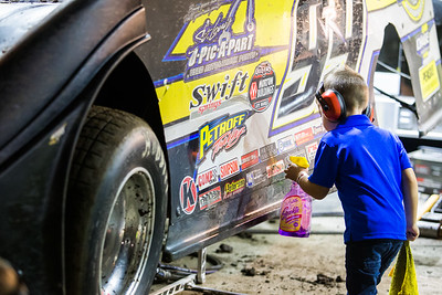 A young man cleaning Frank Heckenast, Jr's car