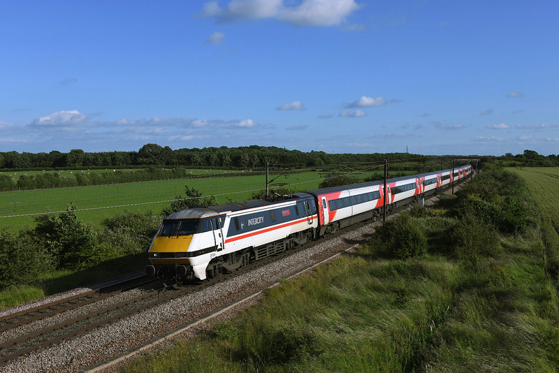 91119 Races north at Colton in  charge of 1S25 16:30 London Kings Cross to Edinburgh LNER service.01/07/2019.