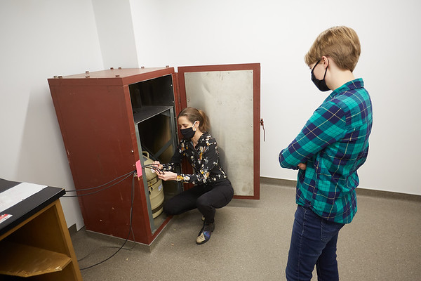 """Lesher explains how to use an instrument for detecting gamma rays, a form of radiation. The detector is kept in a 2"""" lead safe, not to protect students and staff from the instrument but to protect the detector from the background radiation in the room and provide accurate measurements."""