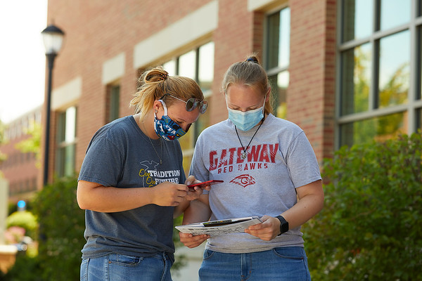 From left, Samantha and Cheyanne Hammiller of Burlington, WI use UWL's Admissions curbside pickup and a QR code tour packet as a way to visit campus safely during COVID-19.