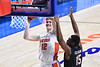 Florida Gators forward Colin Castleton (12) powers up to the basket as the Florida Gators mens basketball team hosted the South Carolina Gamecocks at Exacteh Arena in Gainesville, Florida.  February 3rd, 2021. Gator Country Photo by David Bowie.