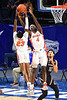 Florida Gators forward Anthony Duruji (4) and Florida Gators guard Scottie Lewis (23) leap for a rebound as the Florida Gators mens basketball team hosted the South Carolina Gamecocks at Exacteh Arena in Gainesville, Florida.  February 3rd, 2021. Gator Country Photo by David Bowie.