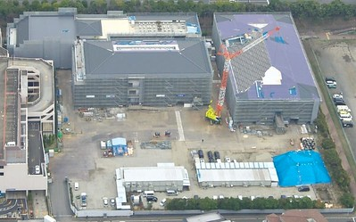 Aerial view of buildings in mid-March. Roofing work has now been completed.