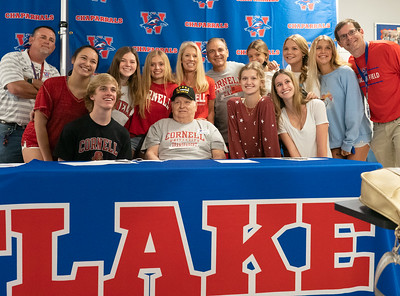 Cassidy Beard celebrates with her family, friends and Head Coach Glen Hafley (L) after signing to run Cross Country/Track at Cornell University during the college signing day at Westlake High School on April 14, 2021. [PAUL BRICK]