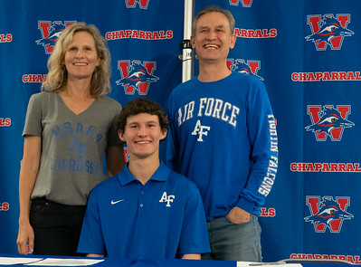 Ollie Lovell celebrates with his family after signing to play Lacrosse at The Air Force Academy, during the college signing day at Westlake High School on April 14, 2021. [PAUL BRICK]