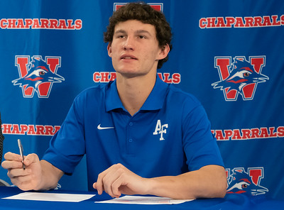 Ollie Lovell signs to play Lacrosse at The Air Force Academy during the college signing day at Westlake High School on April 14, 2021. [PAUL BRICK]