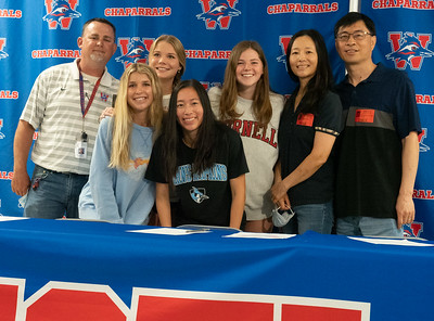 Cassidy Beard celebrates with her family, friends and Head Coach Glen Hafley (L) after signing to run Cross Country/Track at John Hopkins University during the college signing day at Westlake High School on April 14, 2021. [PAUL BRICK]