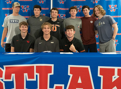 Christian Fournier (C) celebrates with his friends after signing to play Lacrosse at The United States Military Academy, during the college signing day at Westlake High School on April 14, 2021. [PAUL BRICK]